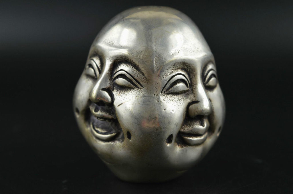 Quatre visages Tête de Bouddha